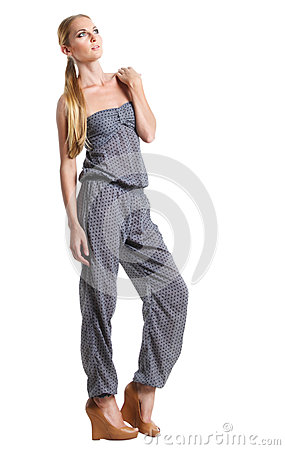 Portrait of the beautiful blonde girl in overalls