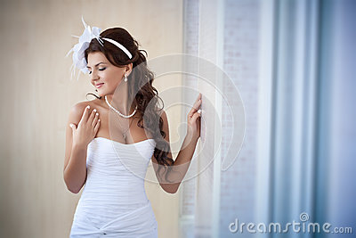 Portrait of beautiful bride in a white dress