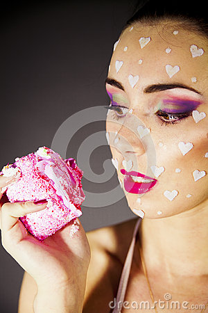 Portrait beautiful brunette  eating cake