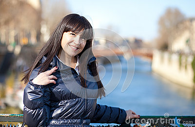 Portrait of beautiful brunette tourist in Paris