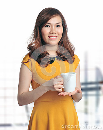 Portrait of beautiful business woman holding coffe