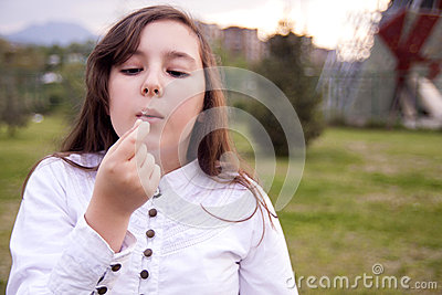 Portrait of beautiful girl blowing flower