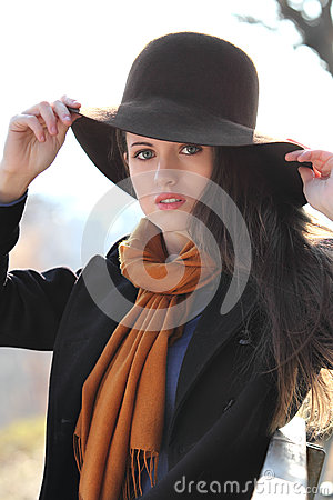 Portrait of a beautiful girl with brown hat