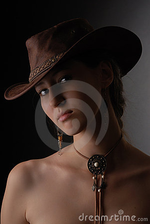 Portrait of beautiful girl in cowboy hat