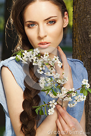 Portrait of beautiful girl with flowers