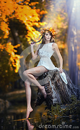 Portrait of beautiful girl in the forest. girl with fairy look in autumnal shoot. Girl with Autumnal Make up and Hair style