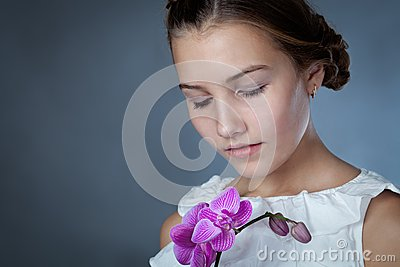 Portrait of beautiful girl on gray background