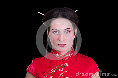 Portrait of beautiful girl in red japanese dress  isolated on bl