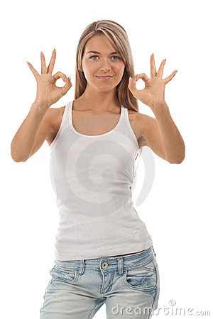 Portrait of beautiful girl showing OK sign