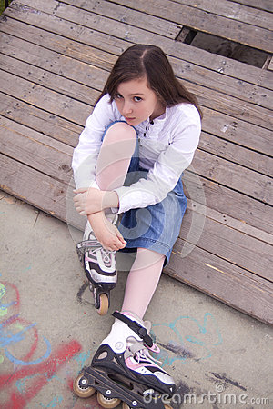 Portrait of beautiful girl with skates