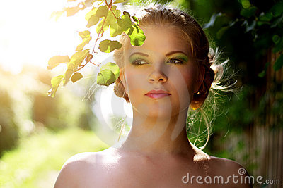 Portrait of a beautiful girl with summer make-up