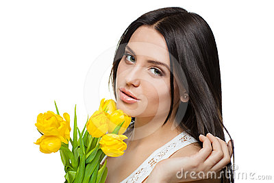 Portrait of beautiful girl with tulips
