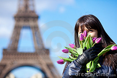 Portrait of a beautiful girl with tulips in Paris
