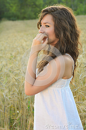 Portrait of a beautiful girl in a wheat field