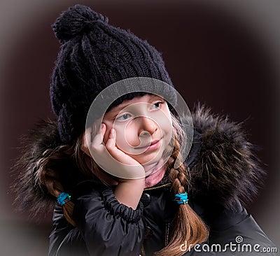 Portrait of beautiful girl in winter cloth