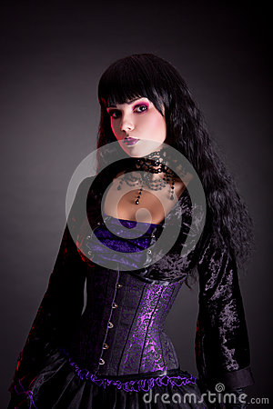 Portrait of beautiful gothic girl wearing Halloween costume
