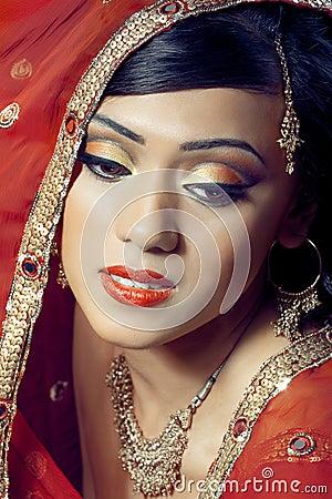 Portrait of beautiful happy indian bride