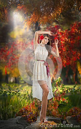 Portrait of beautiful lady in the forest. Girl with fairy look in autumnal shoot. Girl with Autumnal Make up and Hair style
