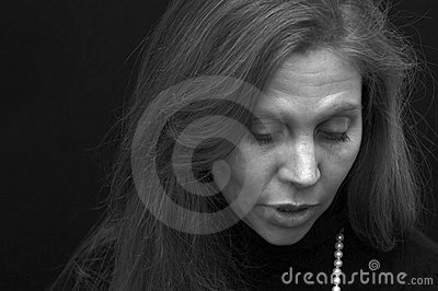 Portrait of beautiful lady looking down talking in