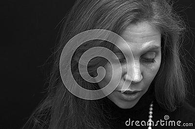 Portrait of beautiful lady looking down talking in