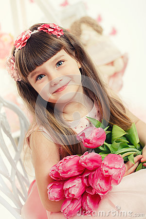 Portrait of a beautiful little girl with flowers