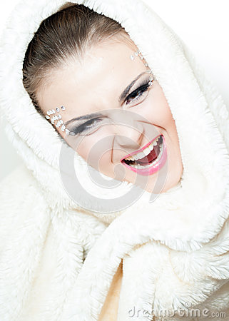 Portrait of the beautiful, shouting girl with a fur hood