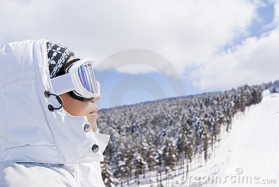 Portrait of beautiful skier looking forward