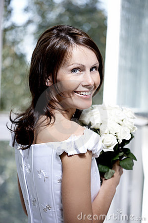 Portrait of the beautiful smiling bride