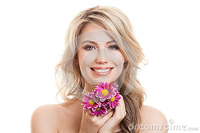 Portrait Of Beautiful Smiling Woman With Flowers. Clear Skin. Stock Photo
