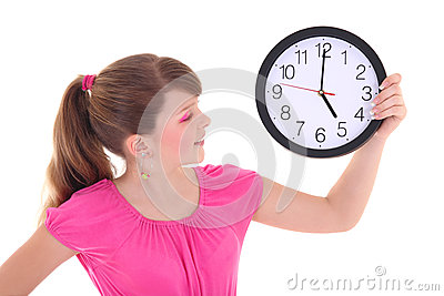 Portrait of beautiful teenage girl with clock isolated over whit
