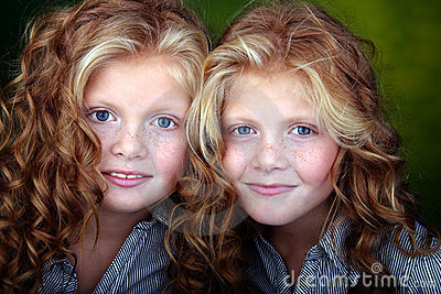 Portrait of beautiful twin girls