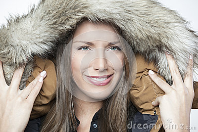 Portrait of a beautiful winter girl isolated on white