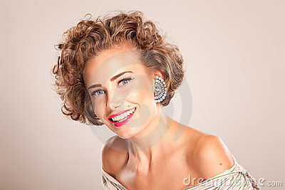 Portrait of beautiful woman with curly hair