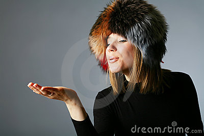 Portrait of a beautiful woman in a fur hat
