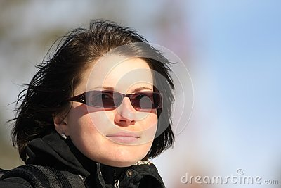 Portrait of a beautiful woman with glasses