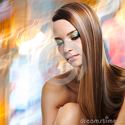Portrait of beautiful woman with long straight hairs