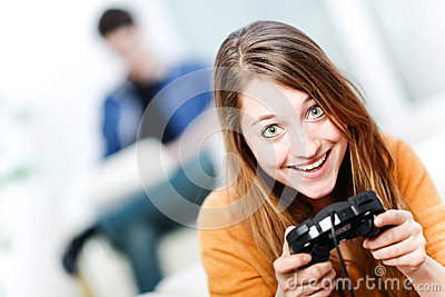 Portrait of beautiful woman playing videogame at home