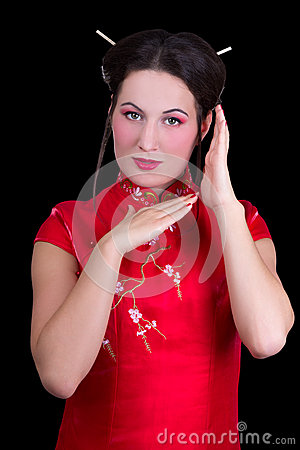 Portrait of beautiful woman in red japanese dress  isolated on b