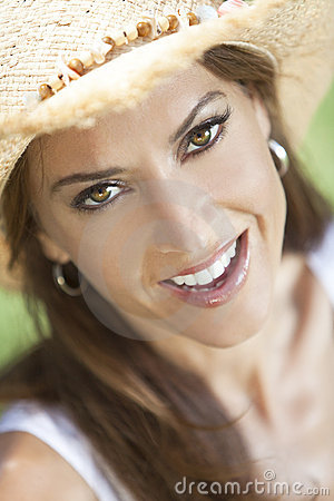 Portrait of Beautiful Woman In Straw Cowboy Hat