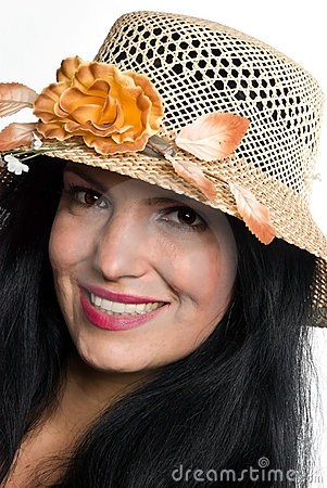 Portrait of beautiful woman with sun hat