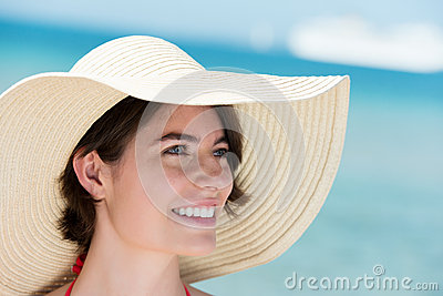 Portrait of a beautiful woman in a sunhat