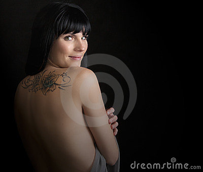 Portrait of a beautiful woman with tattoo