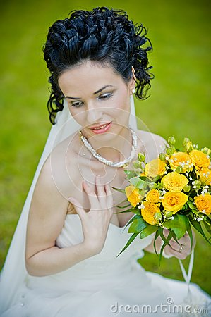 Portrait of beautiful young bride in garden