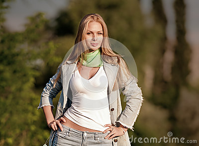 Portrait of beautiful young girl in jeans outdoor