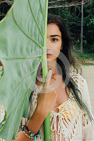 Free Portrait Beautiful Young Woman Against Large Green Leaf Tropical Tree Stock Image - 93872721
