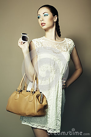Portrait of beautiful young woman with bag
