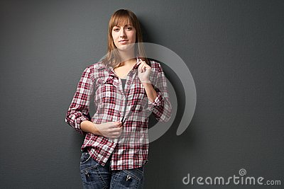 Portrait of beautiful young woman in checkered shirt