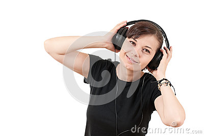 Portrait of a beautiful young woman listening to m