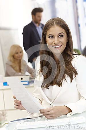 Portrait of beautiful young woman in office