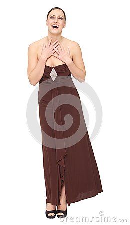 Portrait of a beautiful young woman smiling in long elegant dress